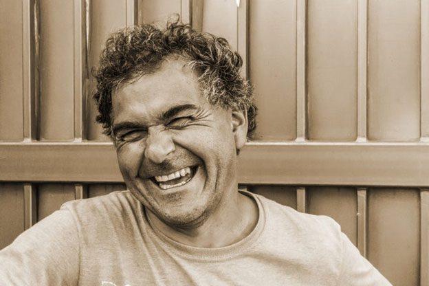 Man smiling, showing his teeth
